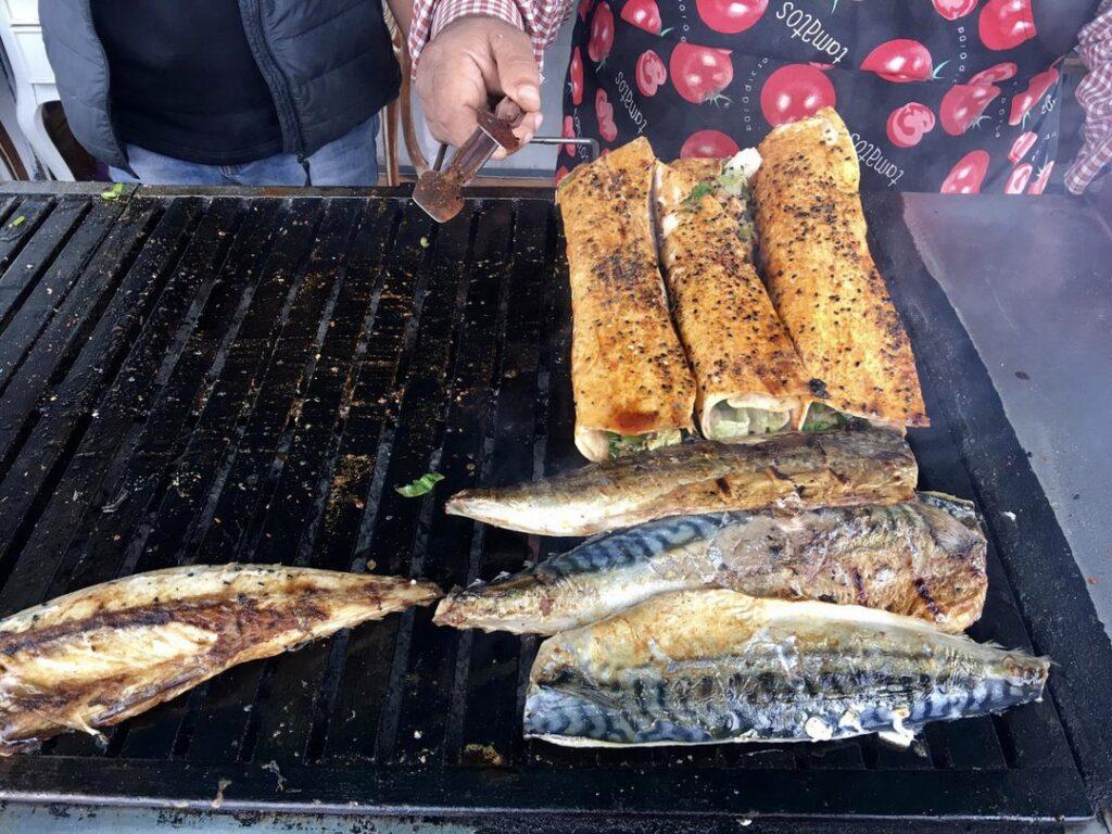 Taste delicious Turkish style fish-burritos during Istanbul night tour