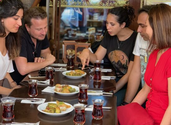 tasting the mouth-watering baklava during the taste of two continents food tour